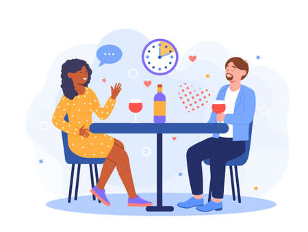 Young man and woman sitting at table and talking