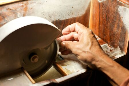 stone cutter: Hands during faceting of gemstone