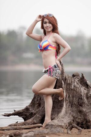 beautiful sexy young woman surfer girl in bikini  photo