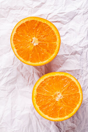 Orange fruit on white Paper texture  photo