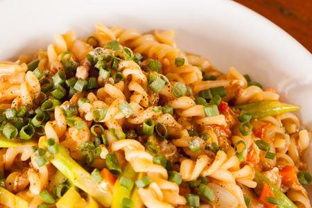 Whole wheat fusilli pasta with pork  photo