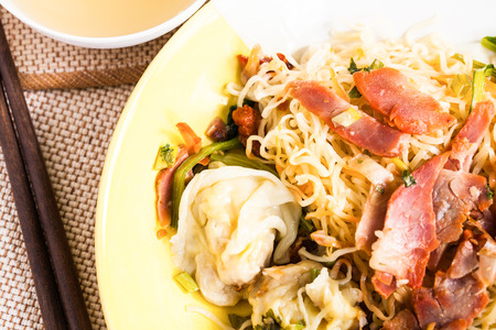 noodles with pork and vegetables. photo
