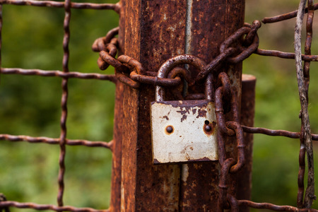 safekeeping: The old rusted lock on a old iron door.