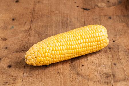 Grains of ripe corn on wood  photo