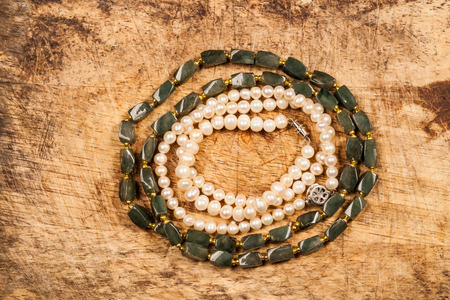 Pearl necklace and jade necklace. photo