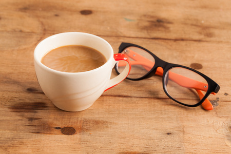 hole in one: cup of coffee and Whole Wheat Bread  Stock Photo