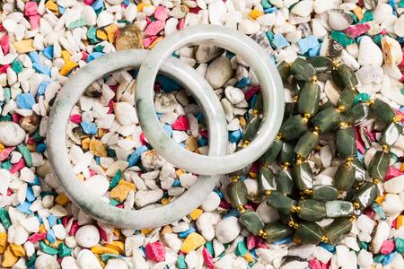 jewelle: jade bracelet on stone background.