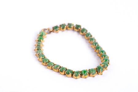 Green Ethnic bead bracelet isolated on white. photo