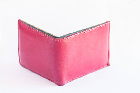 Pink wallet on a white background. photo