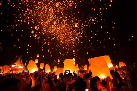 CHIANG MAI, THAILAND - October 25, 2014: Tourists launching Khom Loi in Loi Krathong Festival.