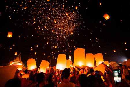 CHIANG MAI, THAILAND - October 25, 2014: Tourists launching Khom Loi in Loi Krathong Festival.