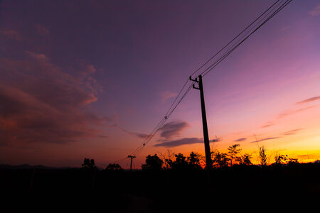 silhouette electricity post with sky cloud. photo