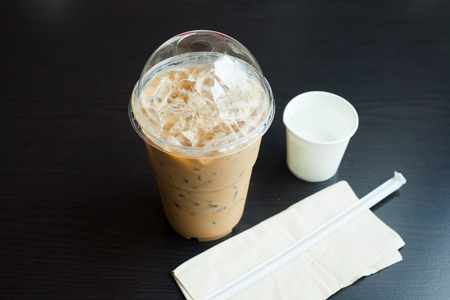 Iced coffee latte on wood table. Stock Photo