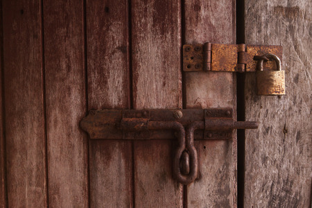 oxidize: locked old wooden door.
