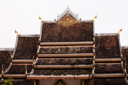 Laos art on roof Church at Thai temple. photo