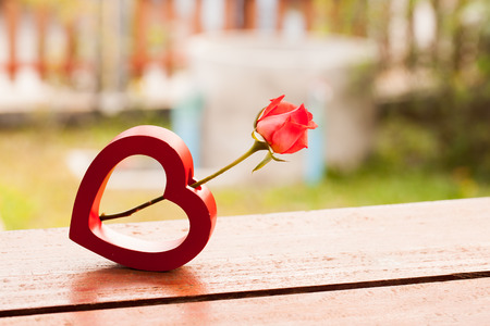 Red hearts and a roses on wooden , Valentines Day background. Stock Photo