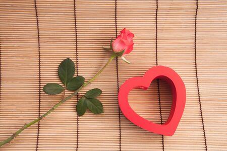Rose on wood . photo