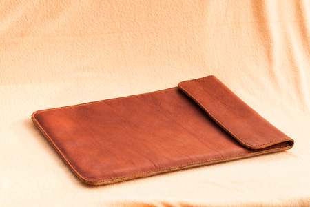 leather briefcase: Vintage elegant brown leather briefcase for laptop computer. Stock Photo