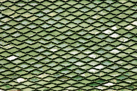 undulation: Green roof tiles made of terracotta background.