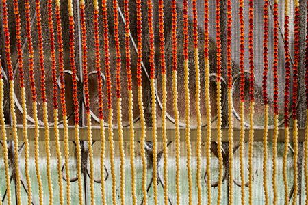 beaded: beaded curtain.