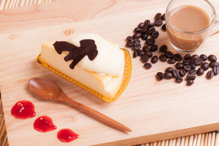 cheese custard cake and cup of coffee on wood. photo