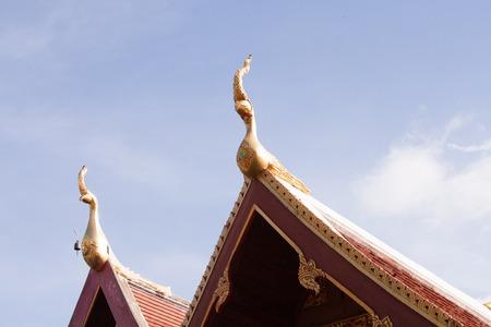 Thai art on roof Church at Thai temple. photo