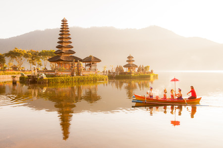 danu: Ulun Danu temple Beratan Lake in Bali Indonesia, June 16 2015 : Balinese villagers participating in traditional religious Hindu procession  in Ulun Danu temple Beratan Lake in Bali Indonesia, June 16 2015 Editorial