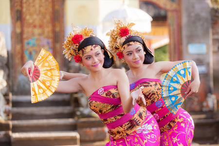 ubud: BALI - June 27 : girl performing traditional Indonesian dance at Ubud Palace Bali theater on June 27 2015 in Bali, Indonesia. Editorial