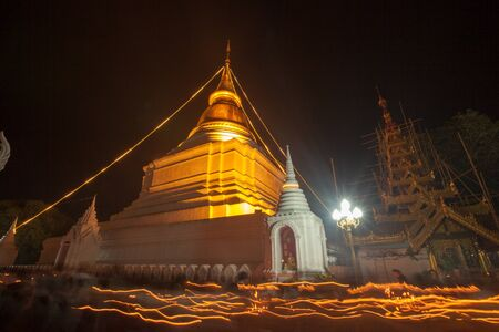 of homage: LAMPANG,THAILAND-JULY 30 ,2015 : Buddhist of Thailand assembled religious rituals homage to the Buddha in the Day before the Buddhist Lent at Wat Phra Kaew Don Tao  in Lampang ,JULY 30,2015 ,Thailand.
