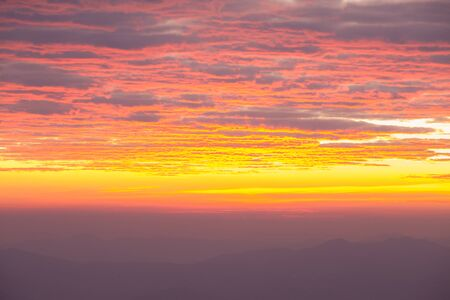 faintly visible: Landscape of sunrise over mountain.
