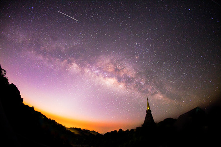wide angle lens: The Milky Way rises over the silhouettes pagoda in Thailand. Shot taken fisheye wide angle lens, Long exposure photograph.