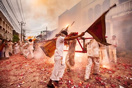 appease: TAKUA PA, PHANG NGATHAILAND - SEPTEMBER 27 : People celebrate a vegetarian festival during the festival ritual mortification is practised to appease the Gods.Action photography Capturing movement.