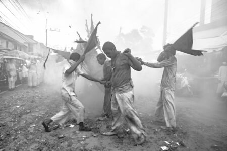 appease: TA KUA PA, PHANG NGA THAILAND - SEPTEMBER 27 : People celebrate a vegetarian festival during the festival ritual mortification is practised to appease the Gods.Action photography Capturing movement.