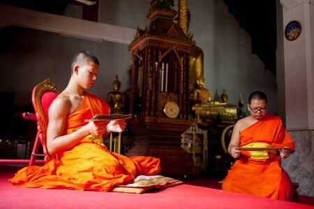 biography: Lampang, Thailand - OCT 5, 2015 : Young novice monks studying Buddhas biography at Wat Pong Sanuk temple on October 5, 2015 in Lampang,Thailand.