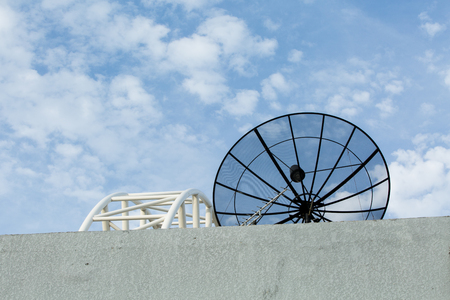 microwave antenna: Satellite dish transmission data on blue sky background. Stock Photo