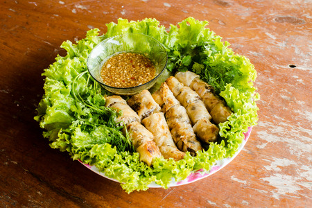 vietnamese ethnicity: A plate of spring rolls with sweet sauce. vietnam food.