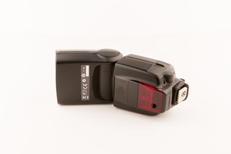 flare up: Photo camera flash isolated on white background.