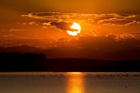 sunset lake: Scenic view of beautiful sunset over lake.