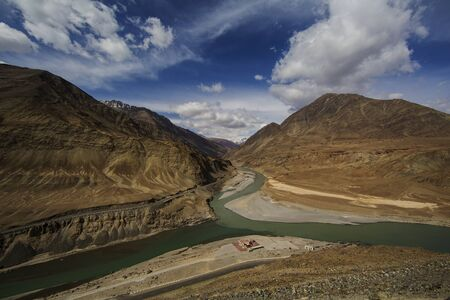 enticing: Top view of confluence of rivers Indus and Zanskar looks enticing from hill road going towards Nemo village.Leh Ladakh, India
