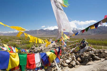 buddhism prayer belief: Tibetan prayer flags at Shey Palace, Ladakh, India