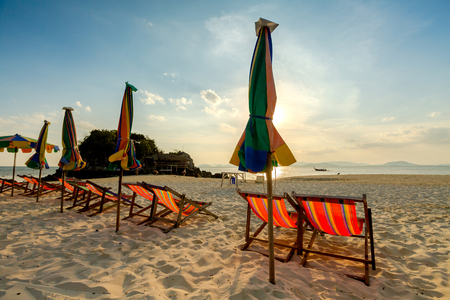 idling: Beach chairs on the white sand beach.