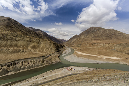 confluence: Top view of confluence of rivers Indus and Zanskar looks enticing from hill road going towards Nemo village.Leh Ladakh, India