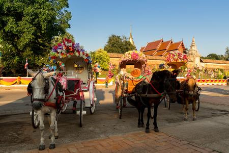 hackney carriage: Traditional Horse Carriage at Wat Phra That Lampang Luang is a Lanna-style Buddhist temple in Lampang in Lampang Province, Thailand.
