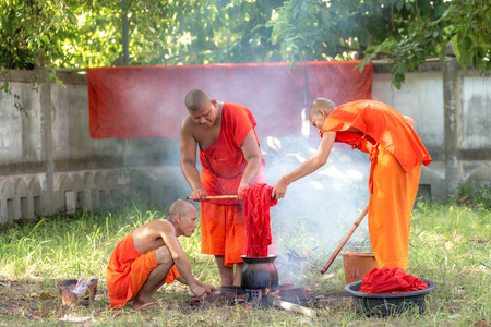 obtained: Yasothon, Thailand. 31 Aug 2016 : The buddhist monk robe dye is allowed to be obtained from six kinds of substances: roots and tubers, plants, bark, leaves, flowers and fruits. They should be boiled in water for a long time to get the dun dye.