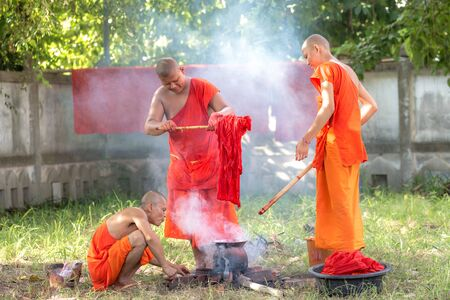 Yasothon, Thailand. 31 Aug 2016 : The buddhist monk robe dye is allowed to be obtained from six kinds of substances: roots and tubers, plants, bark, leaves, flowers and fruits. They should be boiled in water for a long time to get the dun dye.