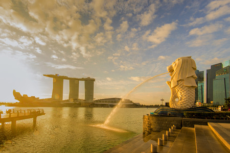 SINGAPORE CITY, SINGAPORE: Sep 29,2017: Sunrise at Merlion and Singapore city skyline with Singapore Flyer.