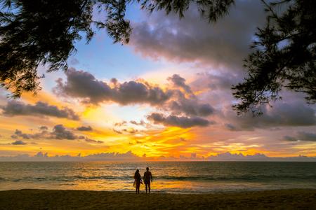couple in love watching sun at sunset on the beach,Phuket Thailand