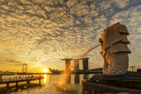 SINGAPORE CITY, SINGAPORE: OCT 31,2017: Singapore Skyline. Singapore`s business district, marina bay sand and the garden by the bay on sunrise Editorial