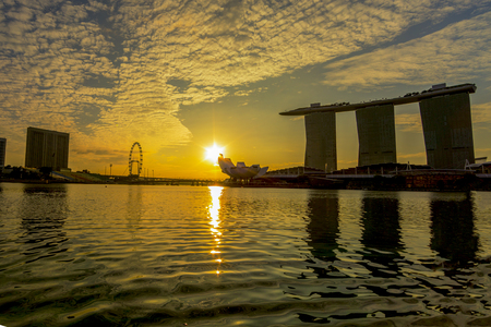 SINGAPORE CITY, SINGAPORE: OCT 31,2017: Singapore Skyline. Singapore`s business district, marina bay sand and the garden by the bay on sunset