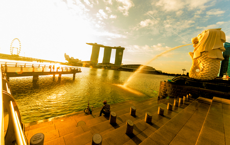 SINGAPORE CITY, SINGAPORE: Jan 2,2018: Singapore Skyline. Singapore`s business district, marina bay sand and the garden by the bay on sunrise